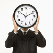 Clock in front of face. — Stock Photo