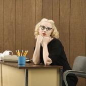 Woman at desk. — Stock Photo
