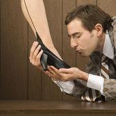 Man kissing woman's foot. — Stock Photo
