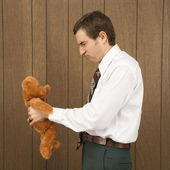 Man with teddy bear. — Stock Photo