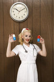 Retro nurse with pills. — Stock Photo