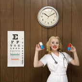 Retro nurse with medicine. — Stock Photo