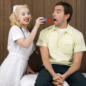 Nurse giving patient pill. — Stock Photo