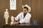 Doctor playing in office. — Stock Photo