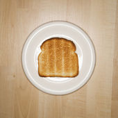 Slice of toast on plate. — Stock Photo