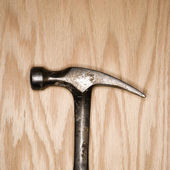 Hammer on wood. — Stock Photo