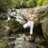 Asian woman doing yoga. — Stock Photo