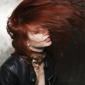 Woman with hair blowing. — Stock Photo