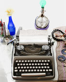 Typewriter with typed on paper sitting on counter. — Stock Photo