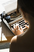 Nude woman typing. — Stock Photo