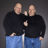 Twin men gesturing. — Stock Photo