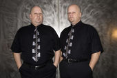 Twin bald men portrait. — Stock Photo