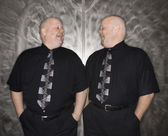Twin bald men laughing. — Stock Photo