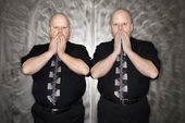 Twin men covering mouth. — Stock Photo