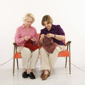 Two women knitting. — Stock Photo