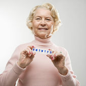 Woman holding pill box. — Stock Photo