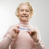 Woman holding pill box. — Stock Photo