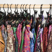 Colorful clothes on rack. — Stock Photo