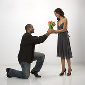 Man giving woman flowers. — Stock Photo