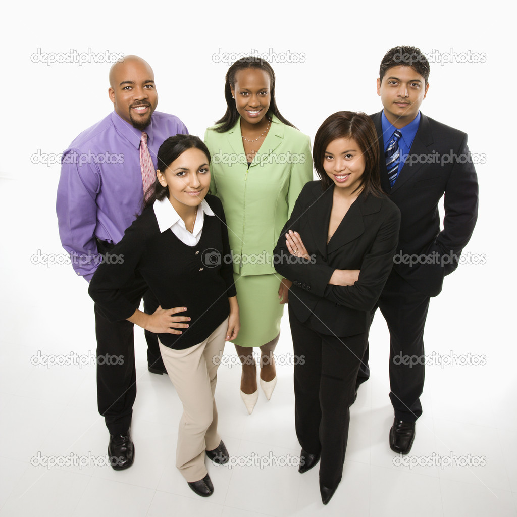 Portrait of multi-ethnic business group standing looking at viewer. — Photo #9530164