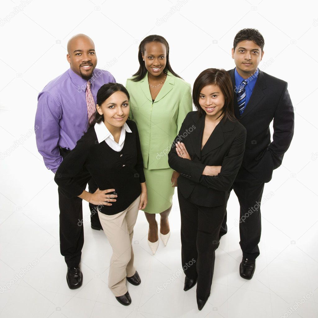Portrait of multi-ethnic business group standing looking at viewer.  Stock Photo #9530164