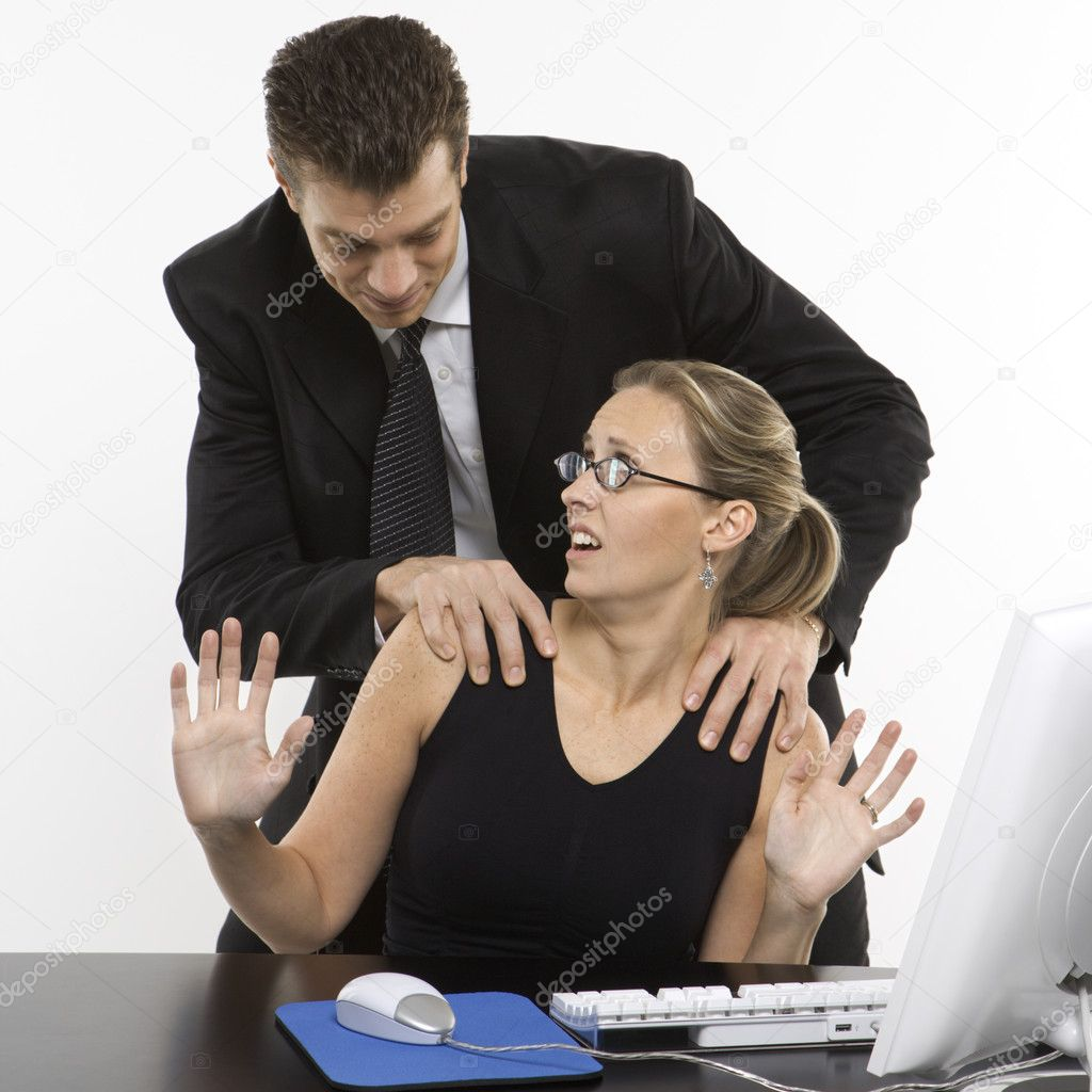 Caucasian mid-adult man sexually harassing woman sitting at computer. — Stock Photo #9530282