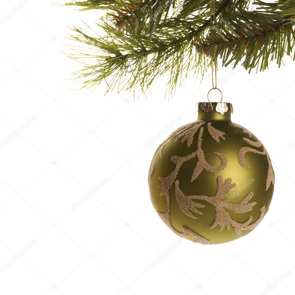 Still life of gold Christmas ornament hanging from pine branch. — Стоковая фотография #9531214
