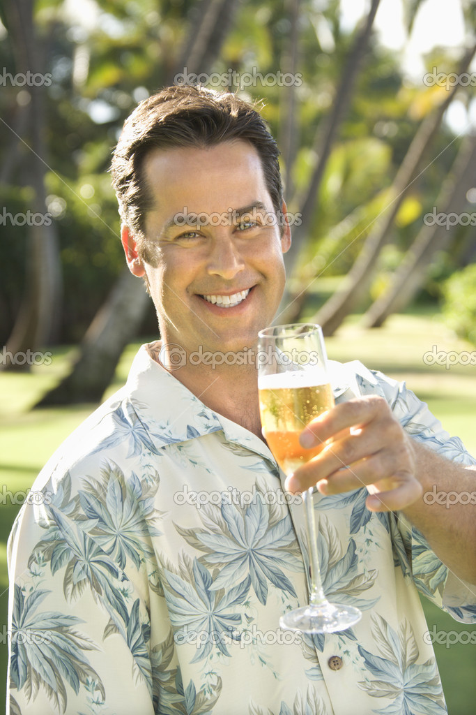 Caucasian mid adult man toasting viewer with champagne glass. — Stock Photo #9531442