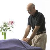 Man massaging woman. — Stock Photo