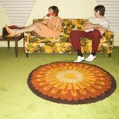 Couple on sofa. — Stock Photo