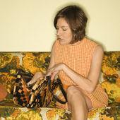 Woman sitting on sofa. — Stock Photo