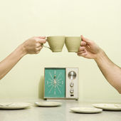 Hands toasting cups. — Stock Photo