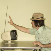 Man tuning in television. — Stock Photo