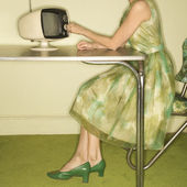 Woman dialing television. — Stock Photo