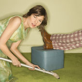 Woman vacuuming carpet. — Stock Photo