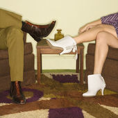 Couple's legs in boots. — Stock Photo