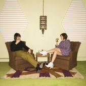 Couple relaxing in chairs. — Stock Photo