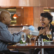 Man Giving Gift to Woman at Restaurant — Foto de Stock