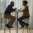 African-American Couple Having Coffee at Cafe - Stock Photo