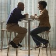 African-American Couple Having Coffee at Cafe — Stock Photo