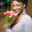 Portrait of Smiling Woman With Tulips — Stock Photo #9550432