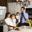 Family in kitchen. — Stock Photo