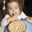 Girl eating cereal. — Stockfoto