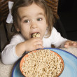 Girl eating cereal. — Stock Photo
