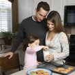 Family with cookies. — Stock Photo #9551807