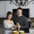 Couple in kitchen. - Stock Photo