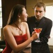 Couple at bar. - Stock Photo