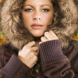 Stock Photo: Woman in hooded coat.
