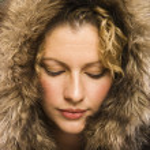 Woman with fur hood. — Stock Photo
