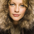Woman with fur hood. — Stock Photo